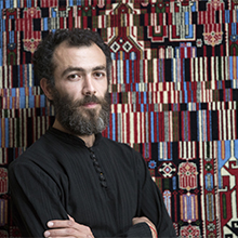 Photo of the artist with his work