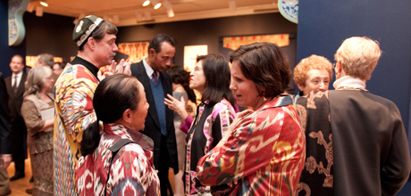 """Members at the opening reception for the museum's 2010 """"Colors of the Oasis"""" exhibition"""