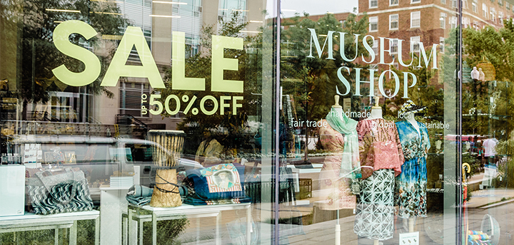 Photo of shop window with sale sign