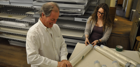 Museum Director John Wetenhall and Associate Registrar Tessa Lummis sleeve textiles for the move to GW.