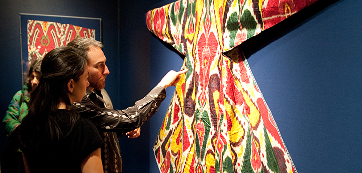 Visitors admire an ikat on display in the galleries