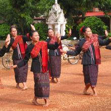 Phu Thai women performing for textile tourists, northeast Thailand