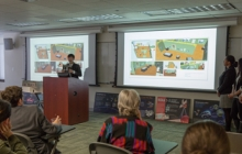 Photo of museum studies students presenting their ideas for one of the new museum's future exhibits on Chinese textiles.