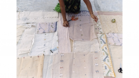 Appliqué artisans laying out jamdani scraps