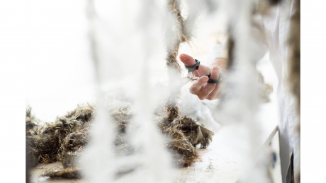 Preparing selvedges from Hosoo brocaded silk and metallic fabrics.