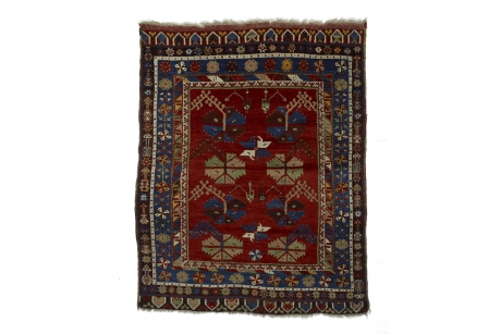 Small red-ground carpet with carnations, probably South-west Anatolia