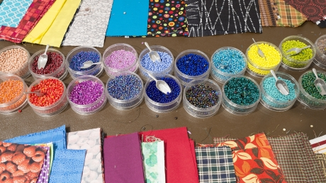 Visitors can use fabric and beads to create their own beaded prayer packets.