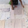 Appliqué artisans laying out jamdani scraps