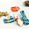 Beaded prayer packets created for the exhibition.