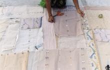 Appliqué artisans laying out jamdani scraps on a base panel, Gujarat, India, 2007.