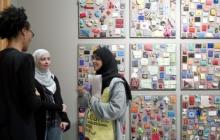 Artist Sonya Clark talks with visitors