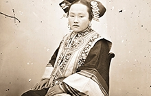 Detail from John Thomson photo of seated Manchu lady