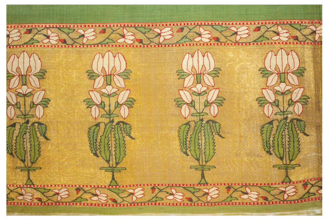 Detail of four white iris plants on textile
