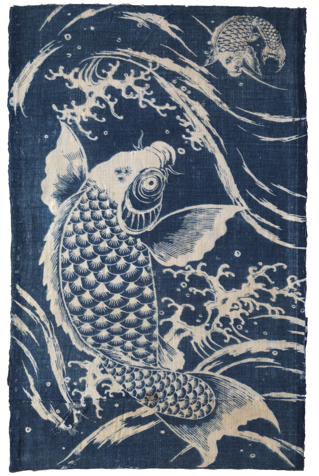 Indigo textile patterned with two carp and waves in white