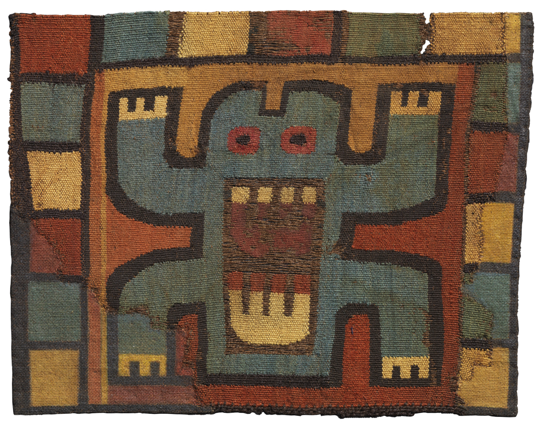 Textile showing frog with teeth