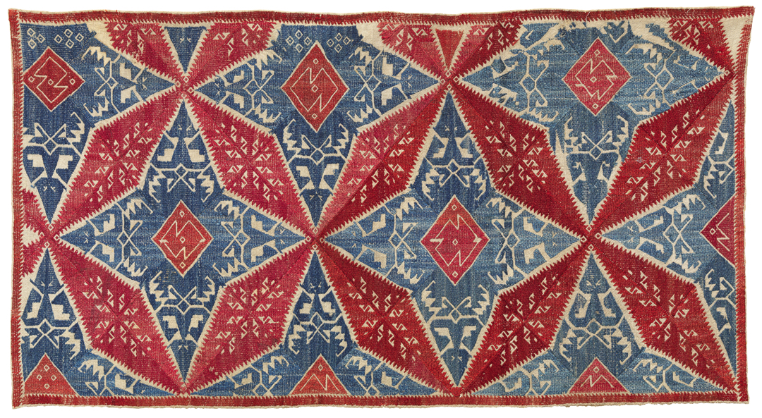 red and blue embroidery with geometric design