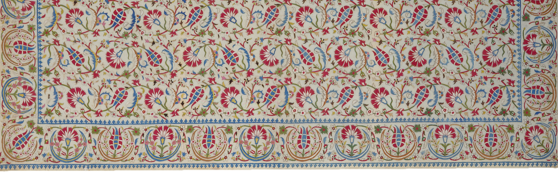 White textile with red and blue