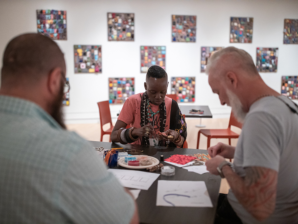 Visitors create their own beaded prayers