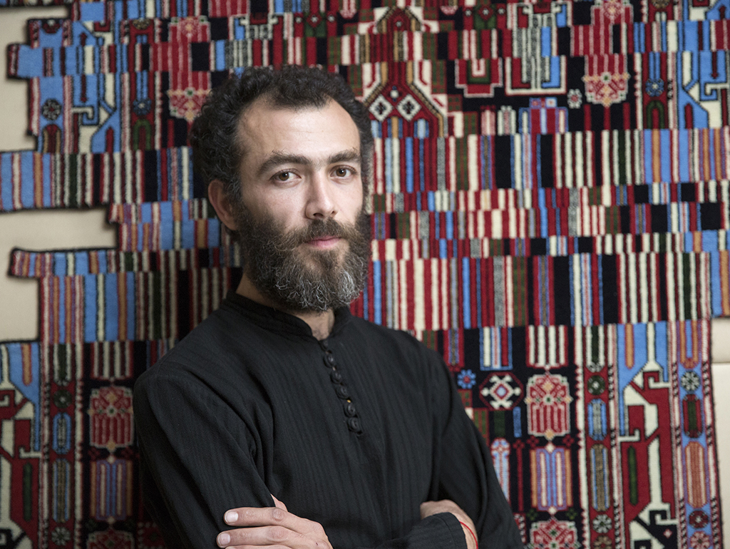 Faig Ahmed with one of his artworks