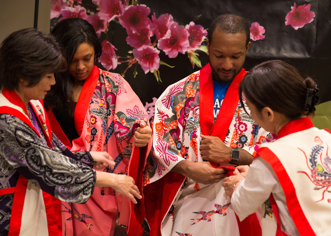 Two visitors trying on kimonos