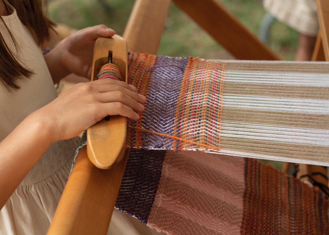Hands of girl weaving
