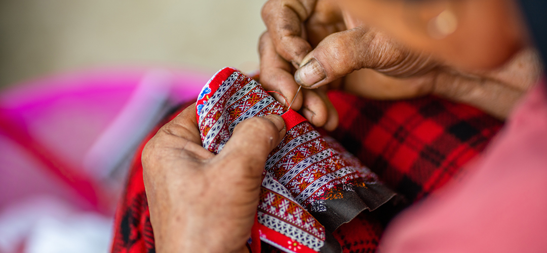 Hands embroidering textile