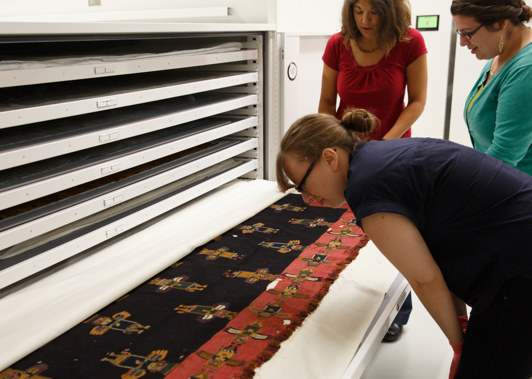 woman looking at textile in drawer