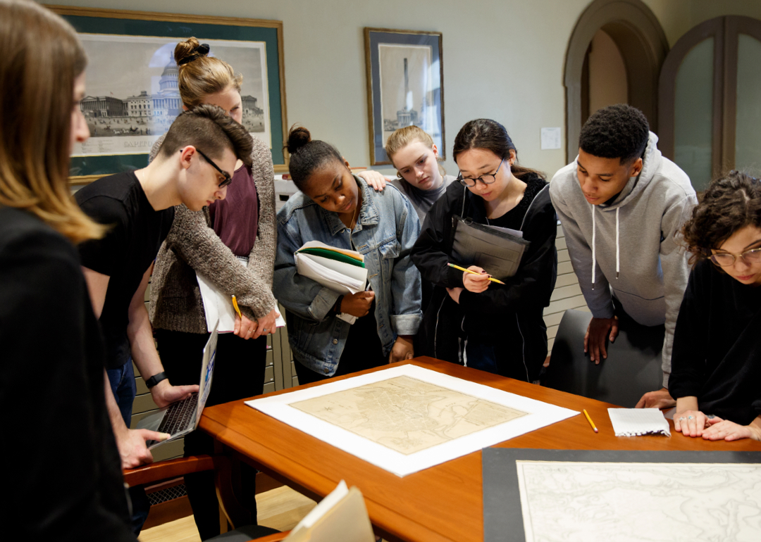Students looking at map on table