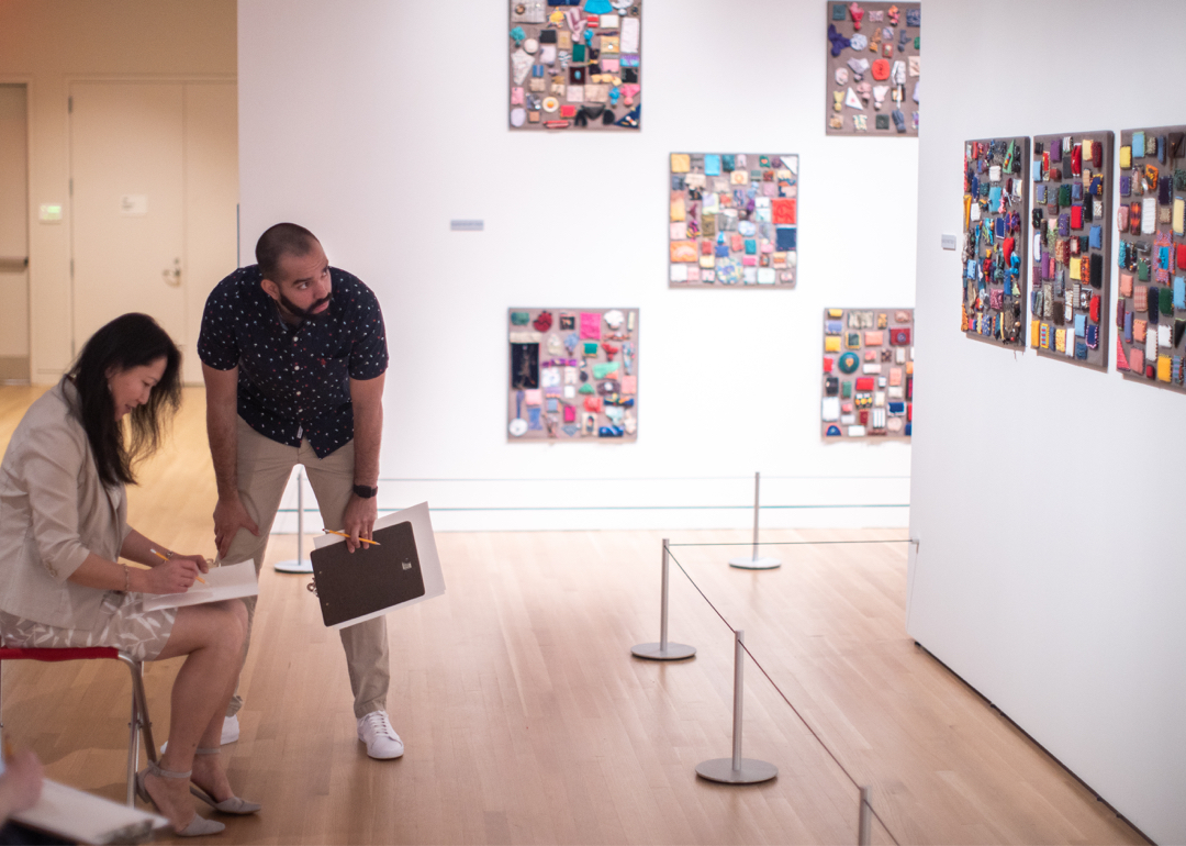 Instructor with a student in the galleries