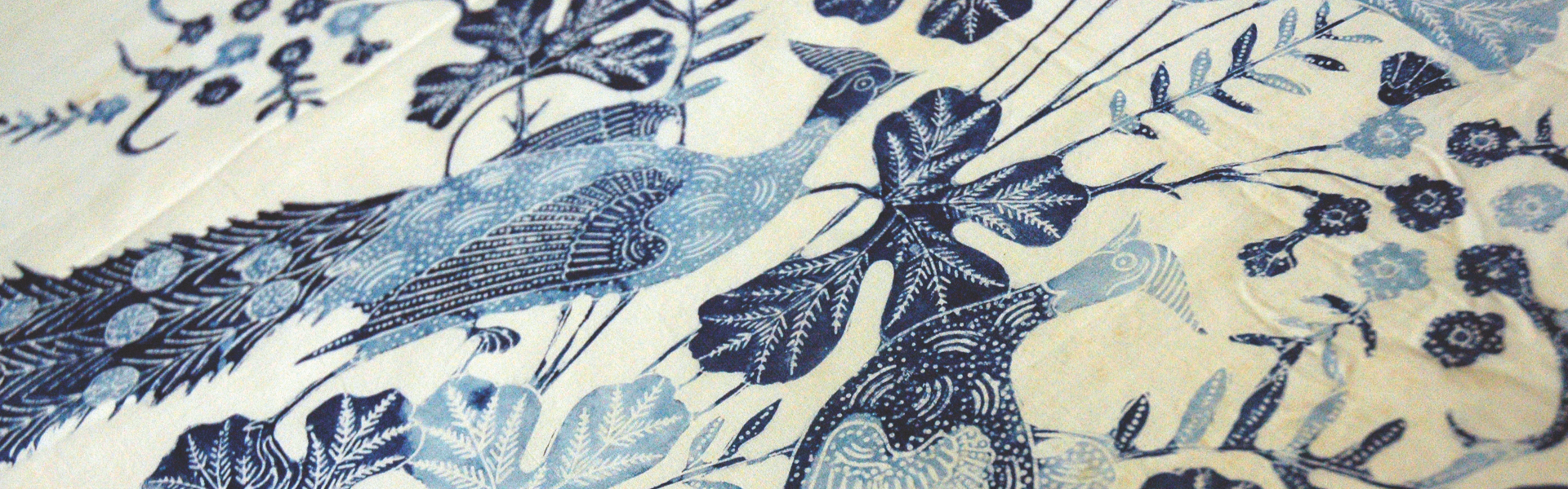 Blue and white textile with birds