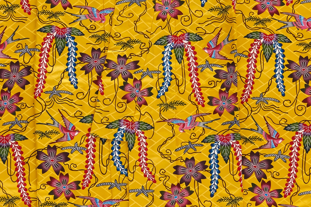 Detail of bingata kimono with flowers and birds on a yellow background