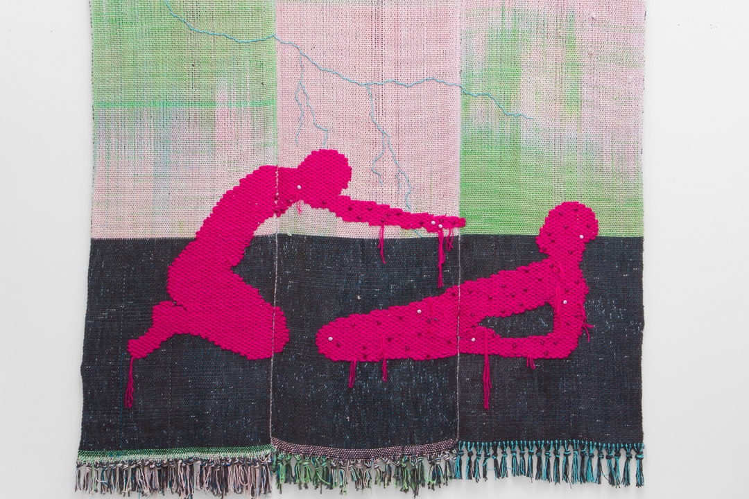 Woven textile featuring two human forms in bright pink