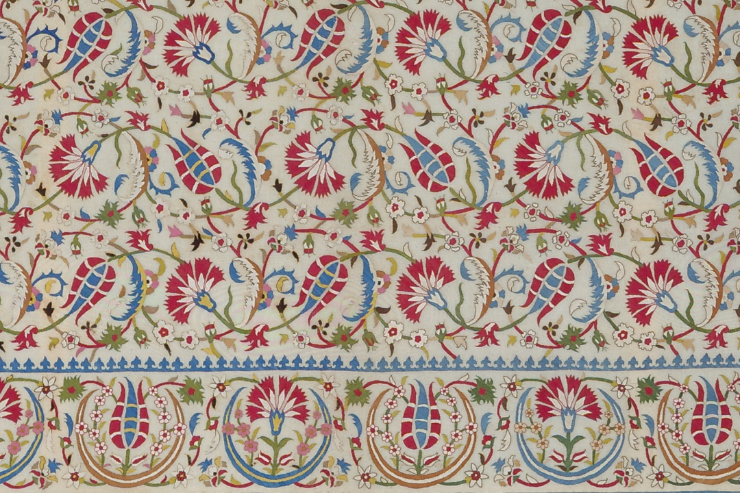 Embroidered bedspread fragment with red, blue, and green floral pattern