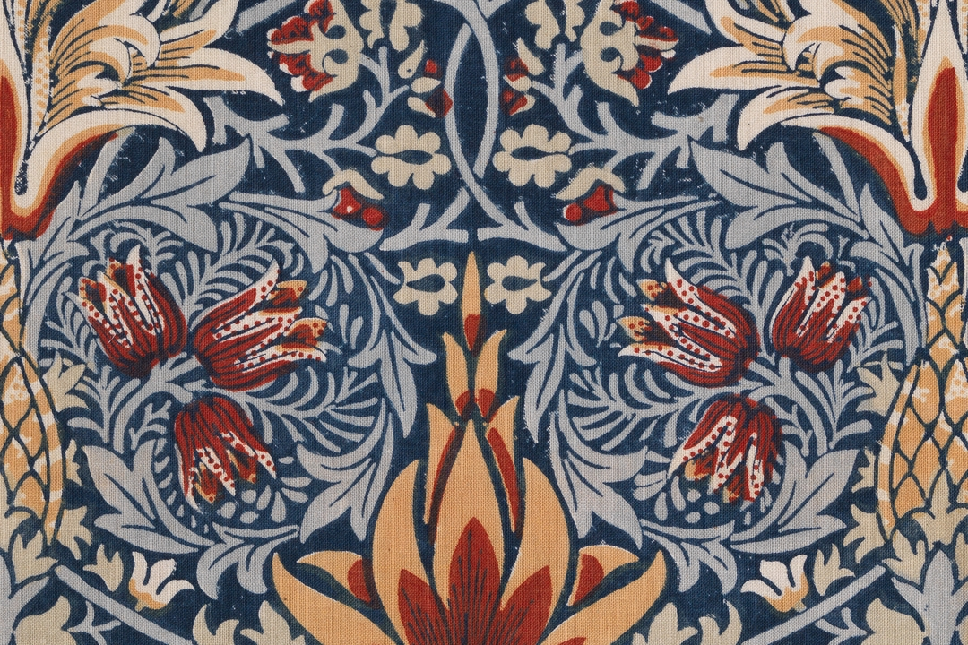 Detail of textile with blue, orange and white floral design