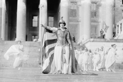 Black and white photo of woman posed as Columbia in front of Treasury Building