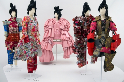 Five mannequins dressed in various ensembles