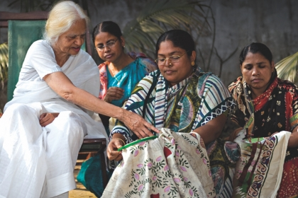Older Bangladeshi women teaching three younger Bangladeshi embroidery techniques