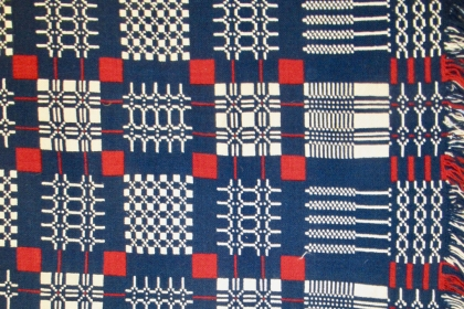 Red, white, and blue coverlet